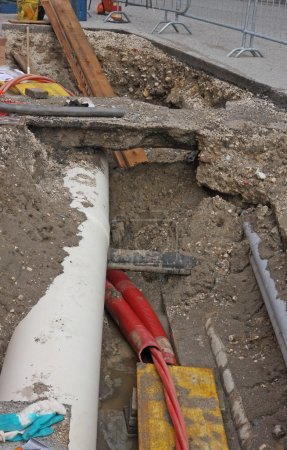 Digging for roadworks during the laying of a conduit for fiber o