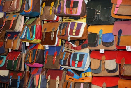 many leather handbags on sale at the local market