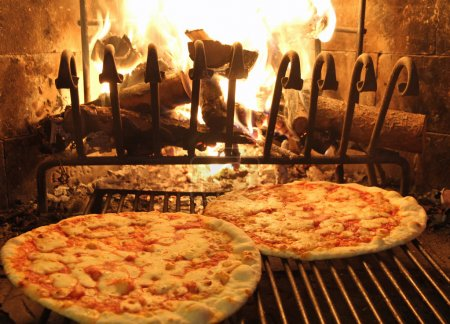 excellent fragrant pizza baked in a wood fireplace 1