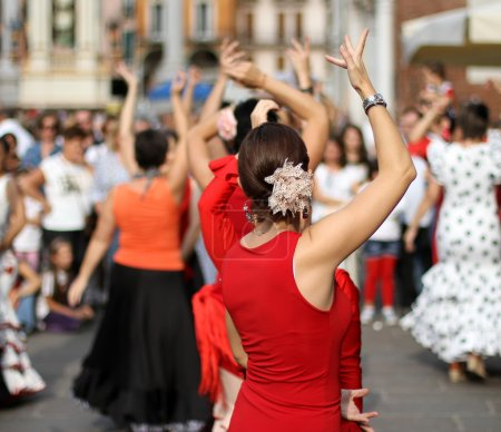Photo for Flamenco dancers expert and Spanish dance with elegant period costumes - Royalty Free Image
