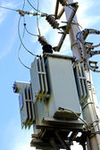 electricity transformer mounted on a pole outdoors