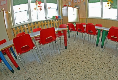 Small red chairs of a kindergarten
