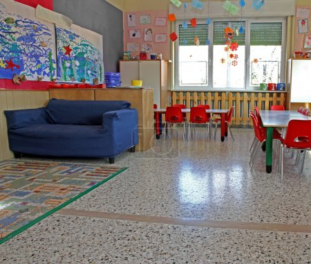Blue sofa and Red chairs in a class of a kindergarten