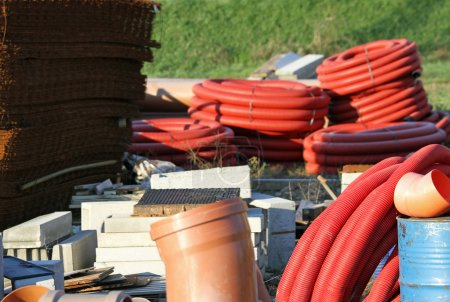 storage of building material and red tubes in a construction sit
