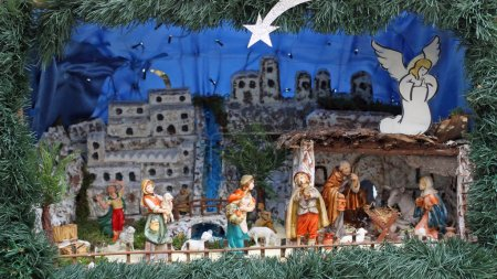 Nativity scene with statues in classical model with pastors