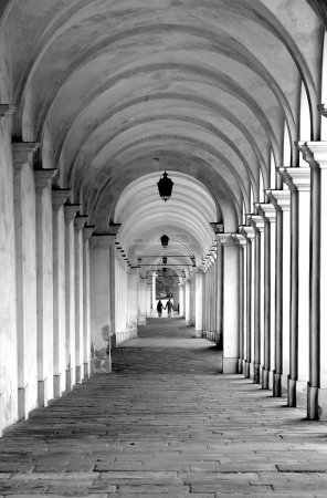 Street with the old arcades and the play of light between column