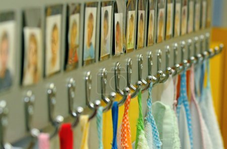 Hooks with towels of nursery school children