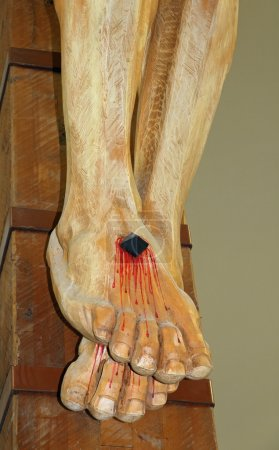 Photo for Feet of Jesus Christ nailed to the cross during the crucifixion - Royalty Free Image