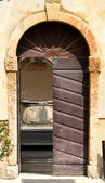 Wooden door of the convent of the Friars and the pit in the cloi
