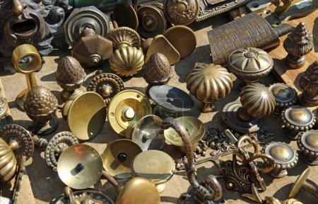 Collection of ancient bronze handles at flea market