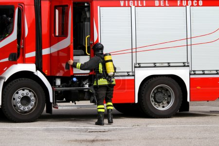 firefighter with oxygen tank in action 3