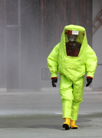 rescuer with the yellow suit against biological hazard from cont