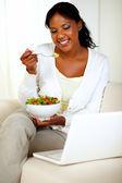Attractive woman eating healthy salad
