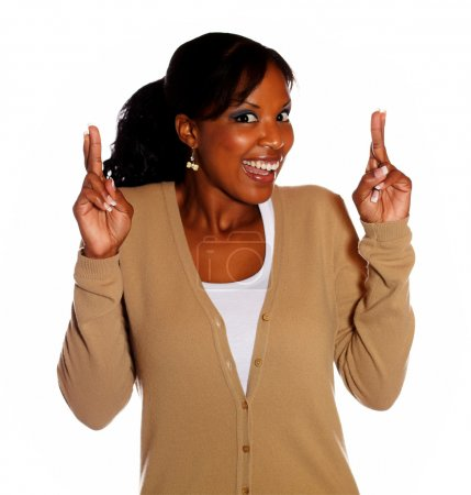 Woman with winning attitude crossing fingers
