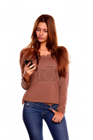 Young woman sending a message with her cellphone