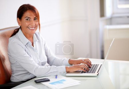 Latin businesswoman working with her laptop
