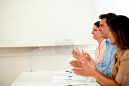 Photo for Portrait of business group giving applause during a conference while smiling and sitting on office - copyspace - Royalty Free Image