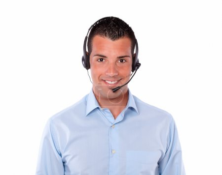 Photo for Portrait of a handsome adult man talking with earphone while smiling at you on isolated studio - Royalty Free Image