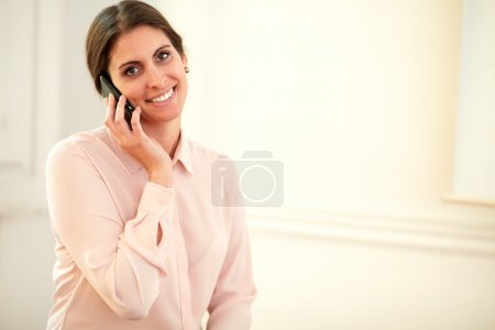 Young 30s lady talking on her cellphone