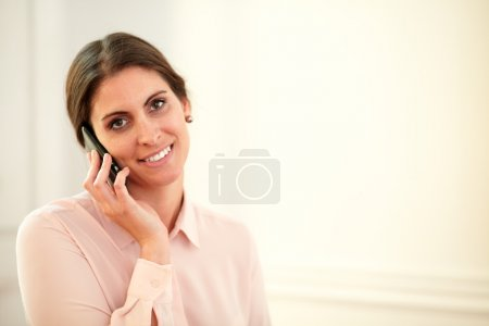 Professional young woman speaking on her cellphone