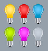 Set of simple and colorful light bulb icons isolated on bluish grey background