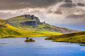 Landscape view of Old Man of Storr rock formation and lake, Scot