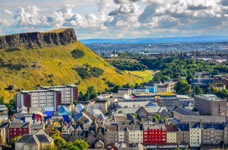 Photo for Edinburgh citiscape view with houses and Salisbury crags, Scotland, United Kingdom - Royalty Free Image