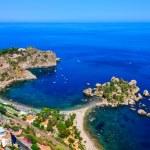 Aerial view of Isola Bella beach coast in Taormina...