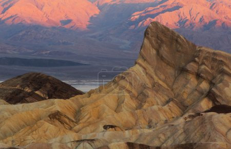 Photo for Zabriskie Point surrounded by a maze of wildly eroded and vibrantly colored badlands - Royalty Free Image