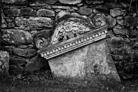 Detail of a grave into a cemetery in black and whi...