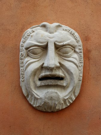Photo for Ancient mask on the wall of the building - Royalty Free Image