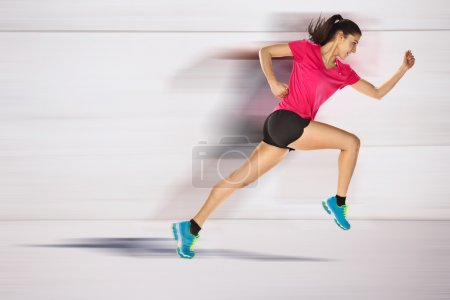 Photo for Young woman jogging front cement wall - Royalty Free Image