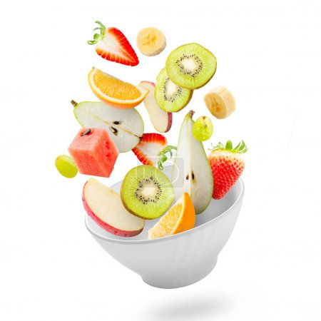Photo for Assorted fresh fruits flying in a bowl - Royalty Free Image