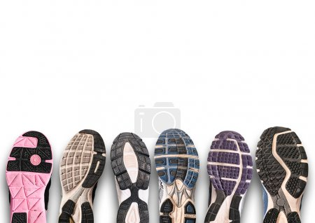 Different shoe sole on a grey background.