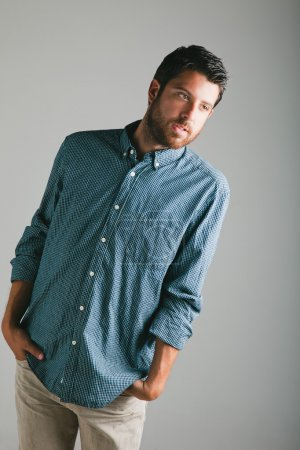 Attractive young man with plaid shirt.