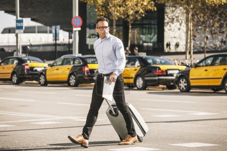 Businessman crossing the street with bag. Goes to the convention.