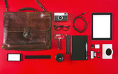 Different photography objects on red background.