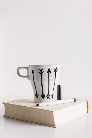 White coffee mug with arrows.