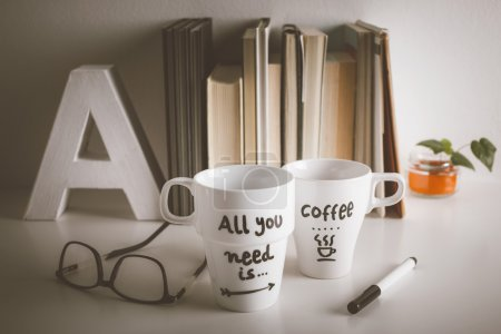 Two white coffee mug with diy decoration on vintage effect.
