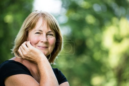Photo for Portrait of happy smiling senior woman - outside on sunny day - Royalty Free Image