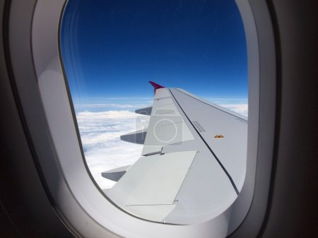 Photo for Window of airplane - flight over white clouds. - Royalty Free Image