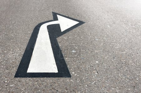 White arrow on asphalt