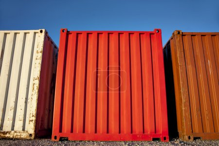 three shipping containers