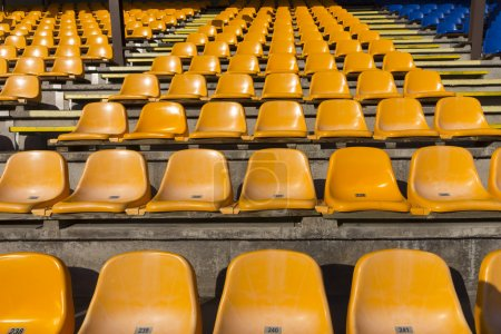 empty yellow seats at sports stadium