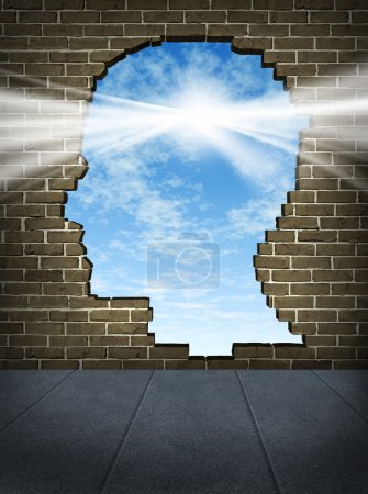 Photo for Power of the mind and free your brain mental health symbol of spirituality and freedom of thought with a human head shaped hole on a brick wall in an urban city stre - Royalty Free Image