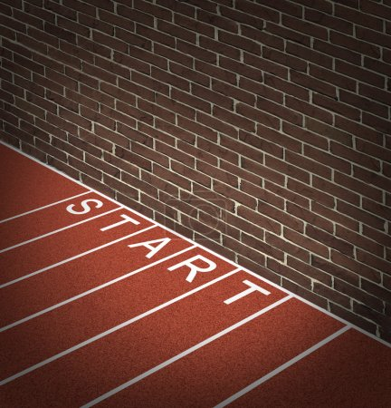 Photo for New business problems as unaccessible closed opportunities and no access to financial oppotunities as a track and field race track start position with a brick wall blocking the way forward. - Royalty Free Image