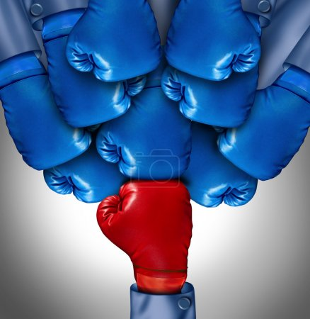 Photo for Overcoming adversity and conquering challenges as a group of blue boxing gloves ganging up on a single red glove as a business symbol of difficult competition environment, - Royalty Free Image