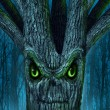 Haunted tree with a mythical dark forest and an ev...