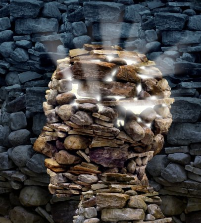 Photo for Power of thinking and free your mind as a business or health care concept with a group of rocks in the shape of a human head glowing with a bright inner light as a symbol of freedom and intelligence. - Royalty Free Image