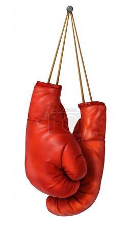Photo pour Gants de boxe suspendu sur un fond blanc isolé avec lacets cloués sur un mur comme une entreprise ou d'un concept de sport d'une personne qui prend sa retraite abandonne le combat ou se prépare à la concurrence. - image libre de droit